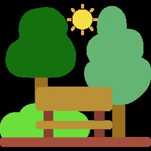 Landschaft mit einer Parkbank im Vordergrund und Bäumen im Hintergrund